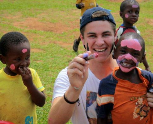 Volunteer with kids in Eswatini
