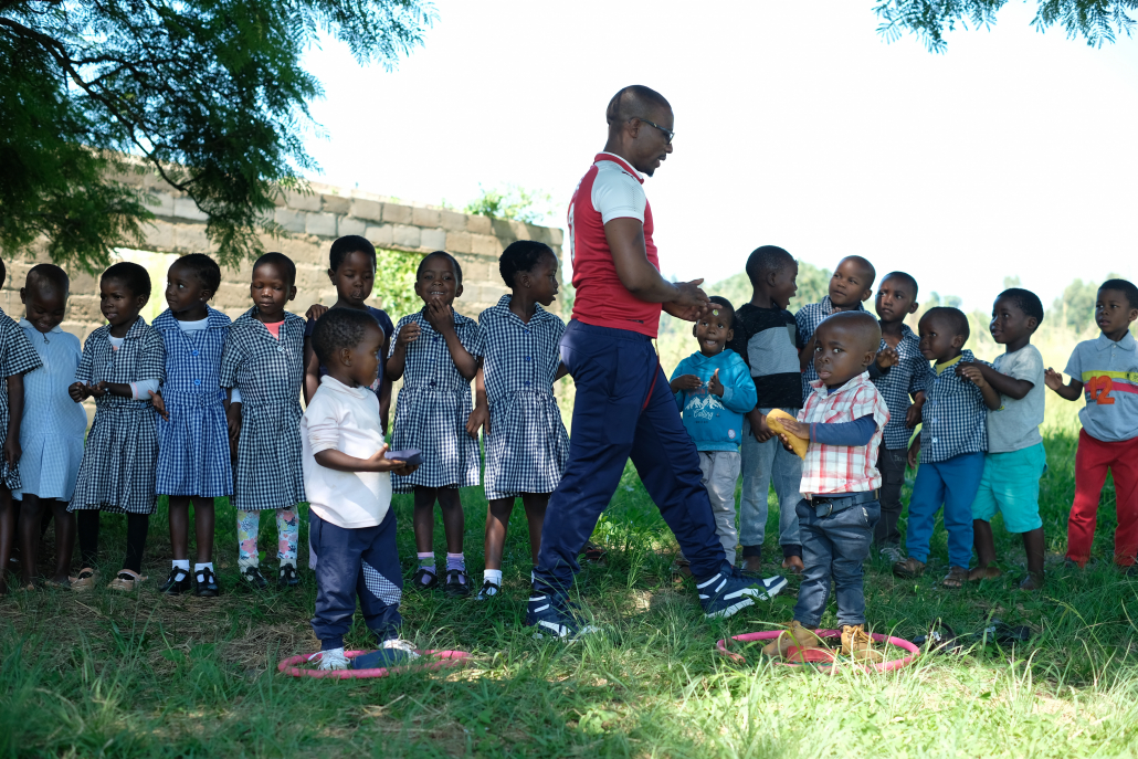 The late sports development coordinator Menzi with NCP children